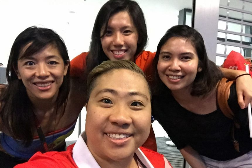 From left: Former swimmer and now MMA fighter May Ooi, swimmer Amanda Lim and bowler Jasmine Yeong-Nathan posing with Theresa Goh (front) for a photo.