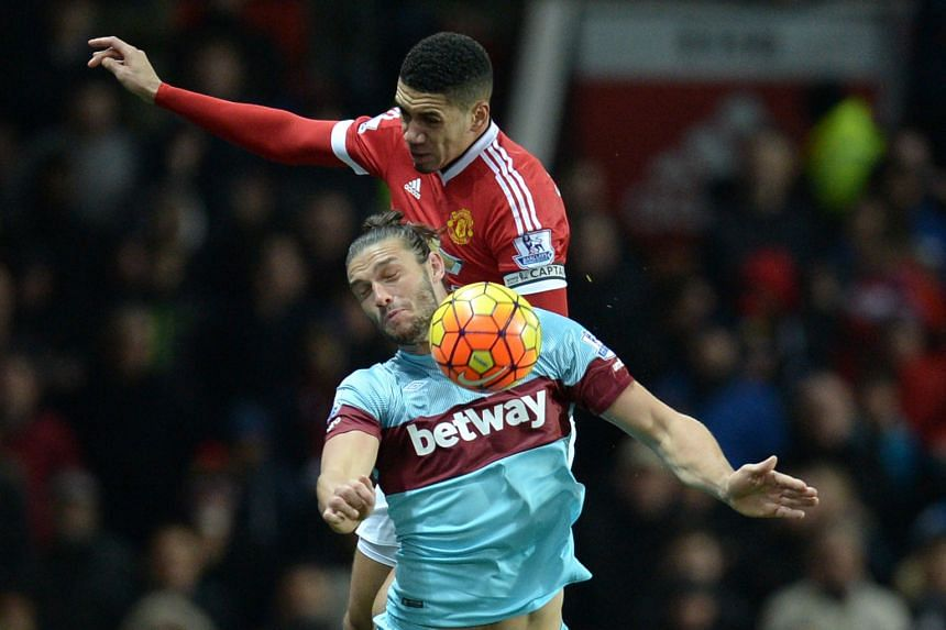 Manchester United defender Chris Smalling (top) keeping Andy Carroll and Co quiet in a 0-0 home draw with West Ham on Saturday to continue an impressive run. He had 22 straight league starts and helped to keep nine clean sheets this season - more tha