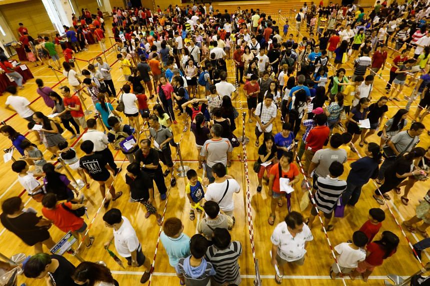 """Some 6,000 low-income families with school-going children received help for the upcoming school year at the Chinese Development Assistance Council's annual """"Ready for School"""" event yesterday at Nanyang Junior College. Acting Minister for Education (S"""