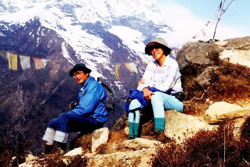 (Left, above) Prof Yap Kian Tiong and his wife Miranda trekking on Mount Everest in 1995. The couple led a full life after they got married in 1981, planning holidays and travelling with friends, though work began to take up more of her time later. (
