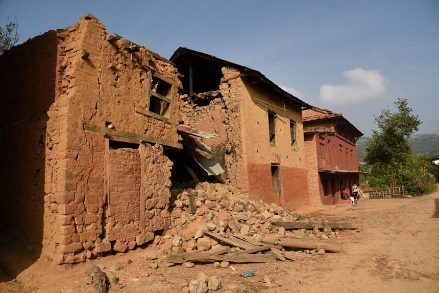 The April 25 earthquake in Nepal left about 9,000 people dead and destroyed 598,000 homes. In places like the town of Bhakunde Besi (above), homes were damaged.