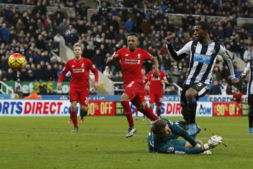"""Georginio Wijnaldum (right) scores the second goal in Newcastle United's 2-0 win against Liverpool at St James' Park on Sunday. Liverpool's Juergen Klopp said of his team: """"We weren't good enough today."""""""