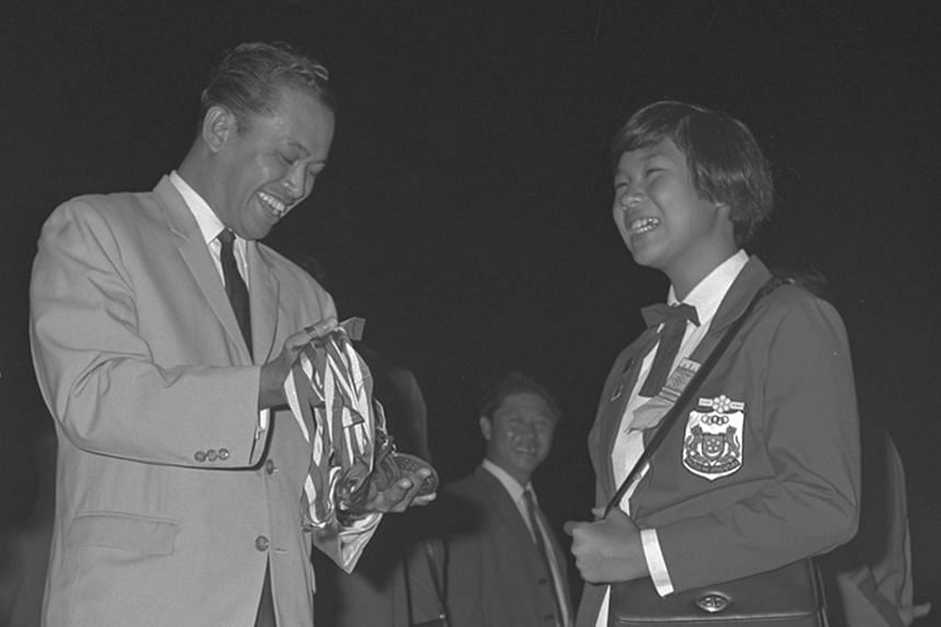 A young Patricia Chan had reason to beam as Minister for Social Affairs Othman Wok looked at the eight gold medals the 11-year-old won at the 1965 SEAP Games. Altogether, Chan (right, in later years) won 39 golds at five SEAP Games (later the SEA Gam
