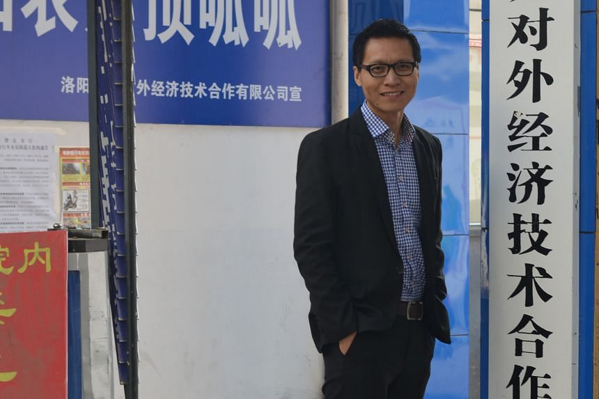 Mr Wang at Luoyang New- Link's branch in rural Songxian. As the firm's vice-general manager, he makes two to three times as much as he did in Singapore. Mr Wang Cheng Jun with his wife Zhang Limin, who works as a nurse in Singapore, and son Zi Hang d