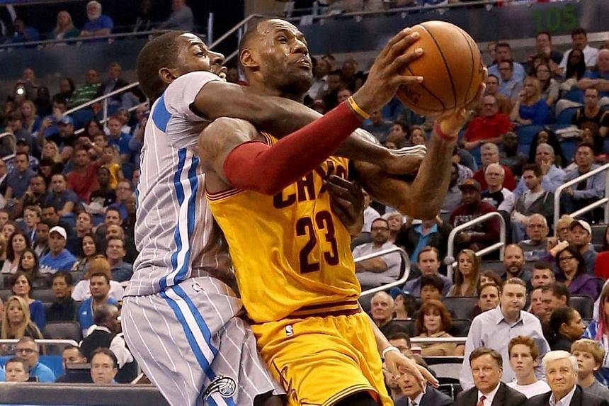 LeBron James (23) of the Cleveland Cavaliers is fouled by Dewayne Dedmon of the Orlando Magic during the Cavs' 111-76 win on Friday. It was the Cavaliers' 12th straight win against Orlando.