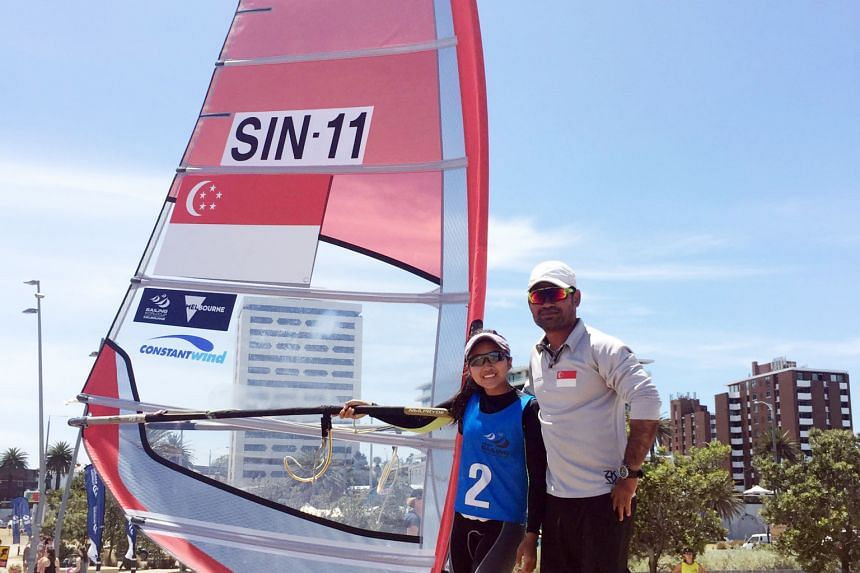 """Above: Audrey Yong, who finished second in the women's windsurfing RS:X competition, flanked by her coach Sakda Sakulfaeng at the Sailing World Cup in Melbourne. Yong, who wants to strengthen her technique in strong winds, said: """"I chose this race be"""