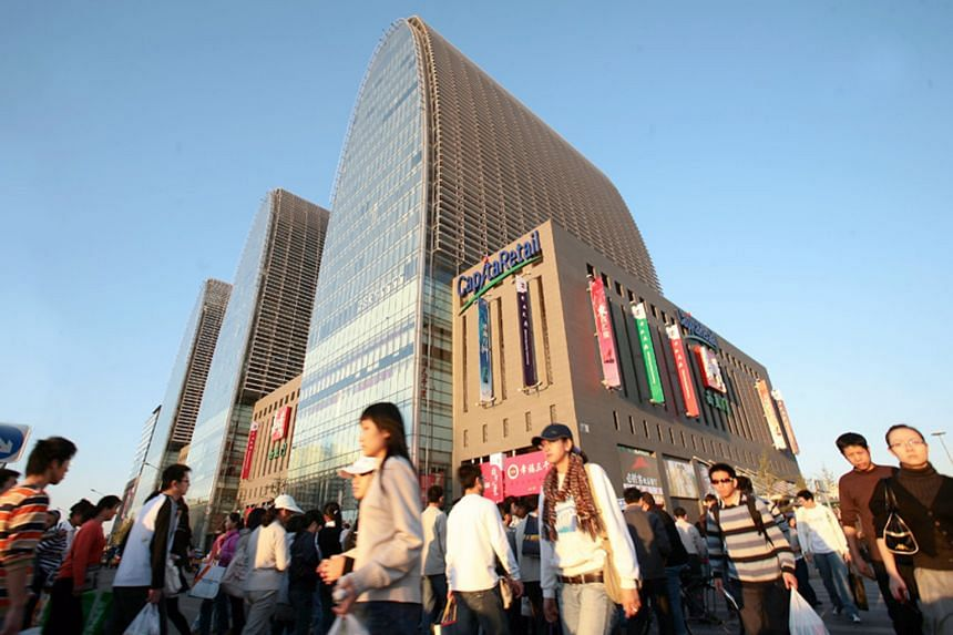 CapitaLand Retail China Trust - which manages the Xizhimen Mall (left) in Beijing - has been singled out by Phillip Securities for its potential, even as analysts expect the S-Reits sector to slow over the next two years.