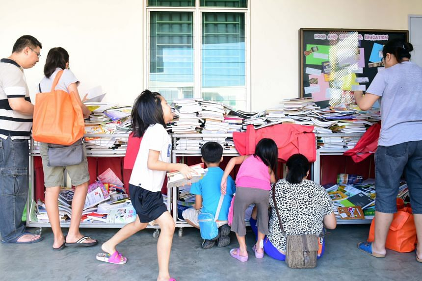Free textbooks being distributed under the Share-A-Textbook Project by NTUC FairPrice at Gan Eng Seng School on Saturday.