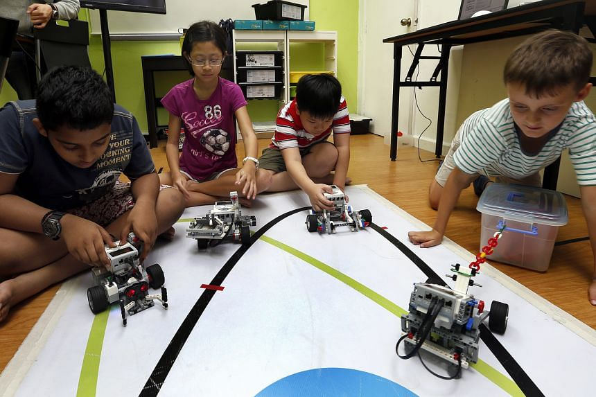 Pupils (from left) Shakthi Vel. P, 10; Marissa Koh, 11; Foo Sze Xiang, seven; and Olivier Bhogal, seven, at a robotics workshop at In3Labs. Marissa, a Holy Innocents' Primary School pupil, said she enjoyed the building process the most.