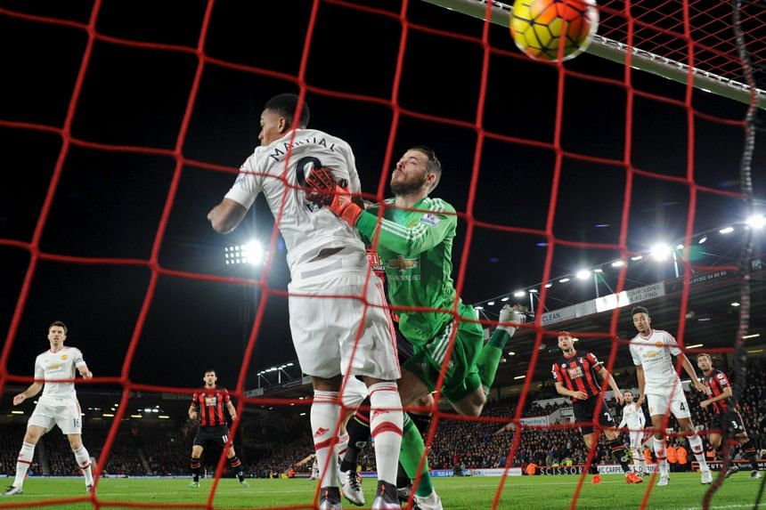 United's David de Gea has no answer to Bournemouth's first goal, from Junior Stanislas (not pictured), in the 2-1 defeat on Saturday.