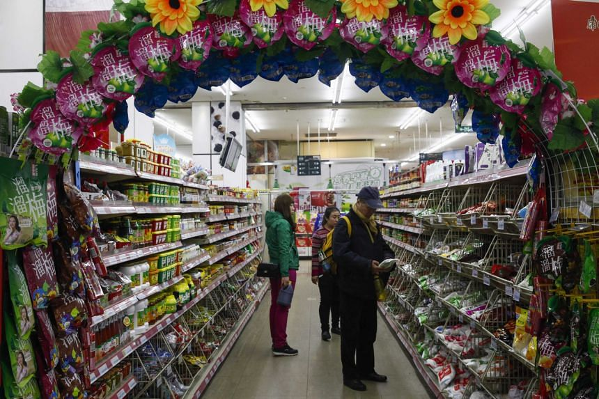 """Shoppers in a supermarket in Beijing. Mr Manish Singhai of Lazard Asset Management is unperturbed by China's sluggish growth, saying that there is a """"gradual but very meaningful move in the composition of the economy"""" with consumption taking off."""