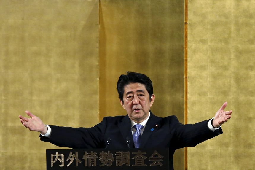 Japanese Prime Minister Shinzo Abe speaking at a lecture event in Tokyo yesterday. Victory in potential double elections next summer would mean Mr Abe need not face voters again until 2019, opening the door for him to push ahead with his long-cherish