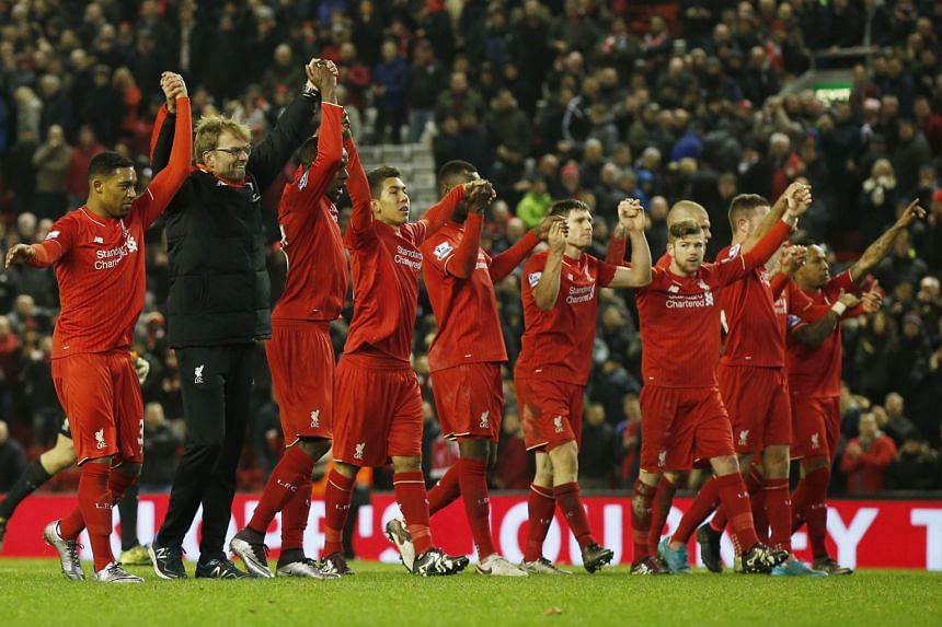 """Juergen Klopp led his players in repeated bowing after salvaging a late 2-2 draw against West Brom on Sunday. He said it was to acknowledge the """"special atmosphere"""" at Anfield."""
