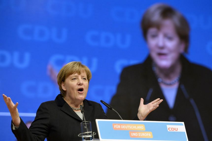 German Chancellor Angela Merkel speaking at the Christian Democratic Union party congress in Karlsruhe, Germany, yesterday.
