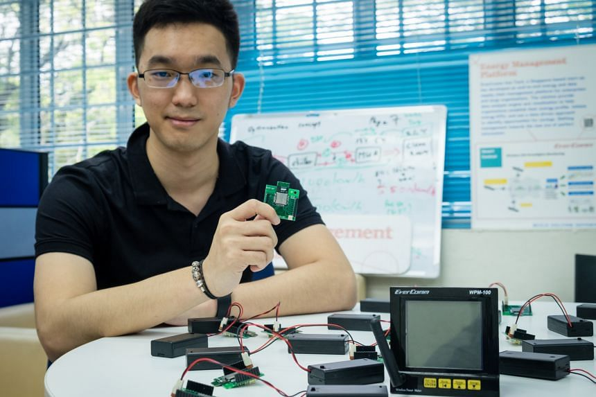 Evercomm Singapore co-founder Ted Chen with a wireless sensor chip, part of an analytic tool that enables firms to find out the exact factors that affect energy consumption.