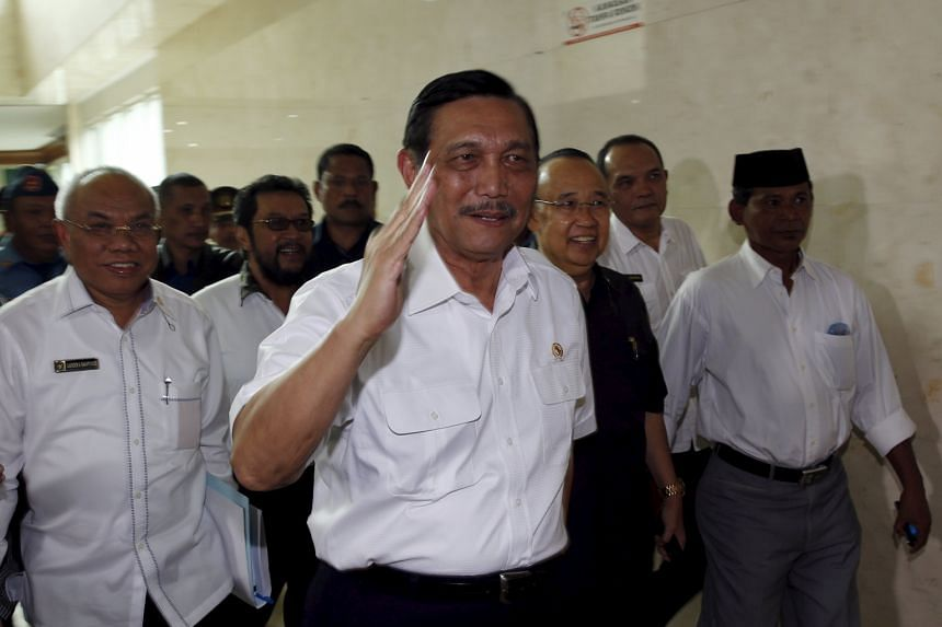 Indonesia's Coordinating Minister for Political, Legal and Security Affairs Luhut Pandjaitan arriving for a parliamentary ethics panel hearing in Jakarta yesterday into the ongoing Setya Novanto-Freeport-McMoRan scandal.