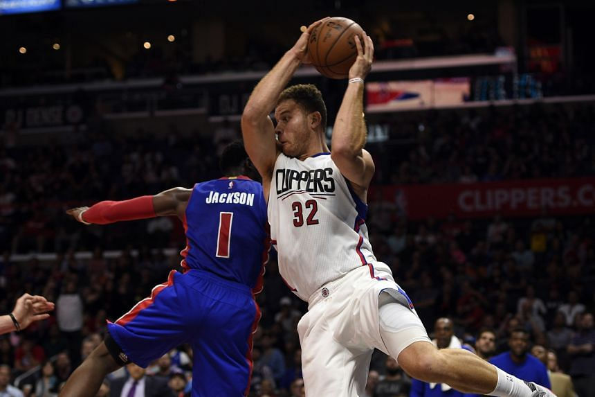LA Clippers forward Blake Griffin (left) attempting to keep the ball in-bounds against Detroit Pistons guard Reggie Jackson in an earlier NBA game at Staples Center.