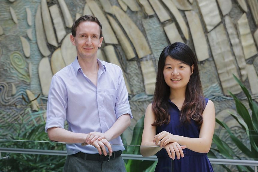 """NUS Assistant Professor Ryan Chisholm and fourth-year student Lin Yuan hope to poll Singaporeans to find out if they are willing to pay a """"haze tax"""" that guarantees good air quality."""