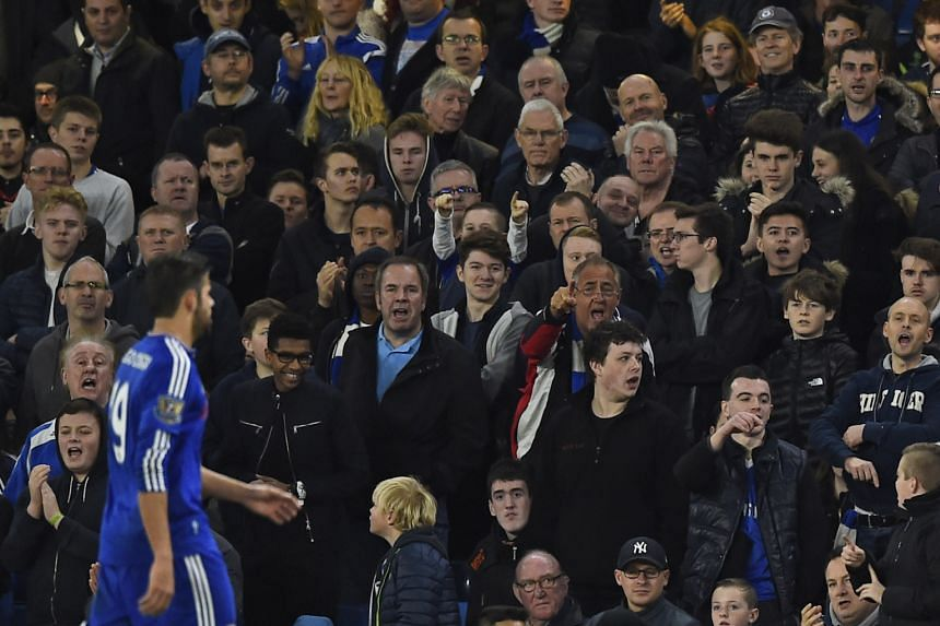 Chelsea fans gesturing and booing Diego Costa off the pitch as he is substituted during the 3-1 win over Sunderland at Stamford Bridge.