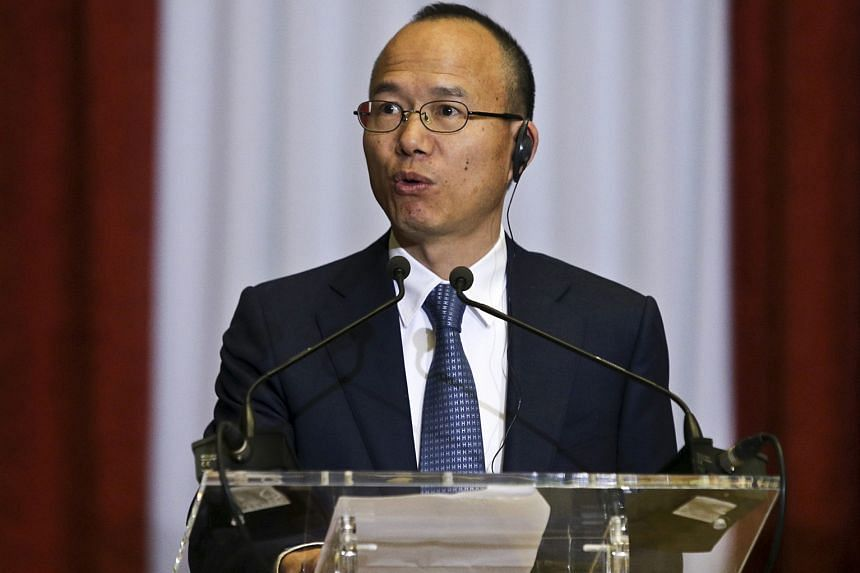 """Mr Guo delivering a speech at the Finance Ministry in Lisbon, Portugal, last February. The billionaire and professed taiji devotee subscribes to a mixture of Buddhism, Taoism, Confucianism and """"Buffettism""""."""