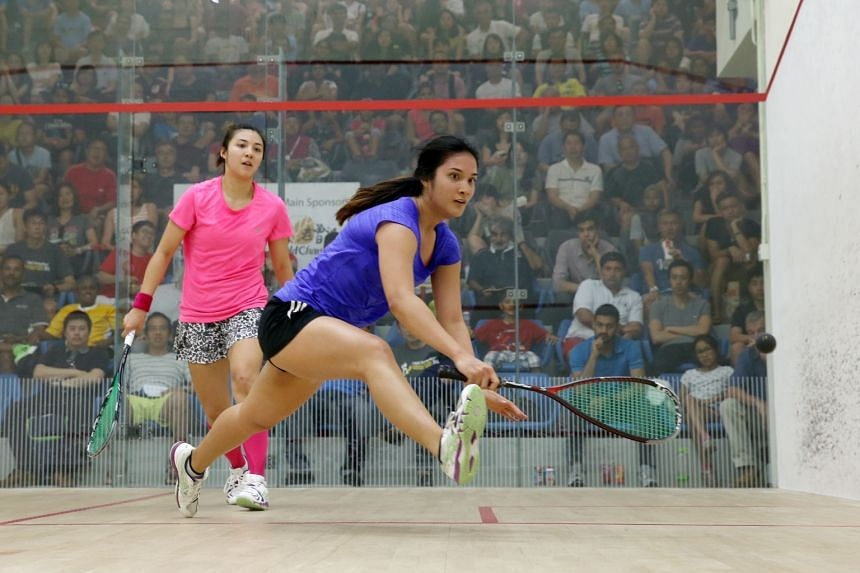 Malaysia's Delia Arnold (left), the world No. 18, bagged her first Singapore Open title with an 11-4, 11-8, 11-2 triumph over her sister Rachel, the 2014 champion. Delia was a British Open semi-finalist in May.