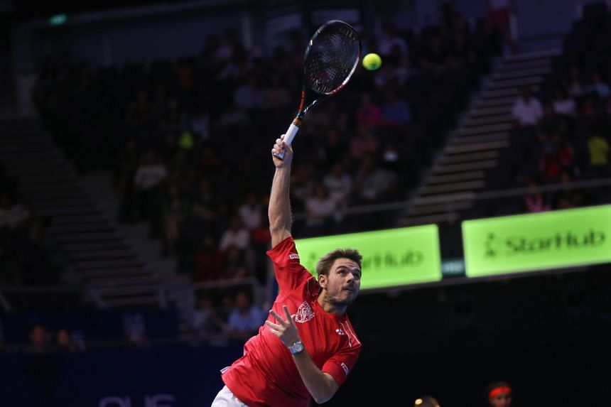 Stan Wawrinka (above) showed his pedigree when he won his singles and doubles matches yesterday to help the Singapore Slammers (left) win this year's IPTL and give home fans plenty to shout about.
