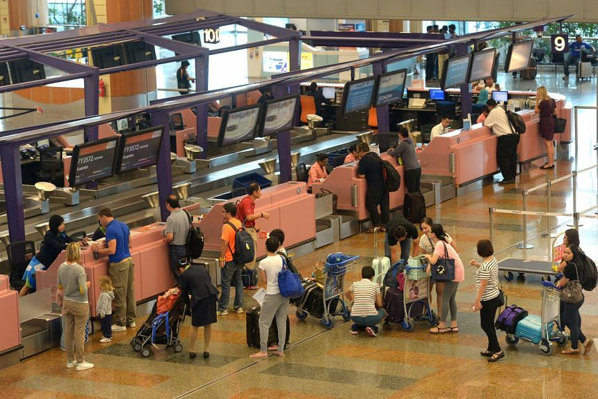 Travellers at Changi Airport. Besides seamless travel within Asean, more than half of Singapore respondents expect their work or travel to increase in the next three years.