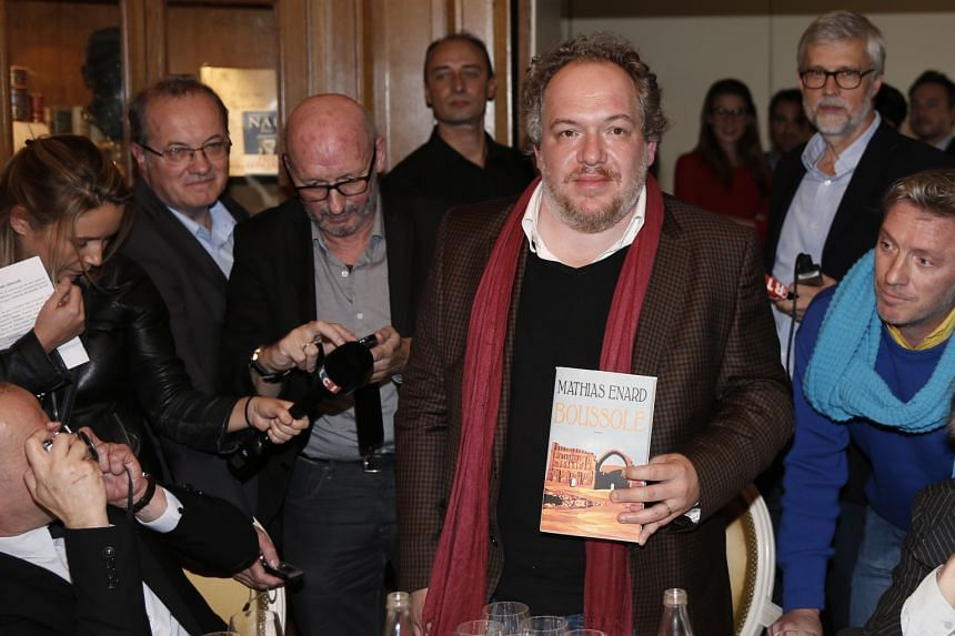 Author Mathias Enard (left, holding his book, Boussole) won the Goncourt Prize for his work which explores cultural exchanges between East and West. The novel 2084 by Algerian writer Boualem Sansal (above left) is a dystopian tale set in a totalitari
