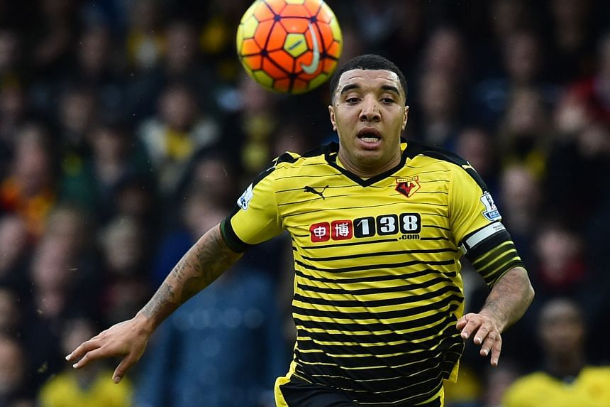 Troy Deeney chasing the ball during the match between Watford and Liverpool. The Hornets defeated the Reds 3-0.