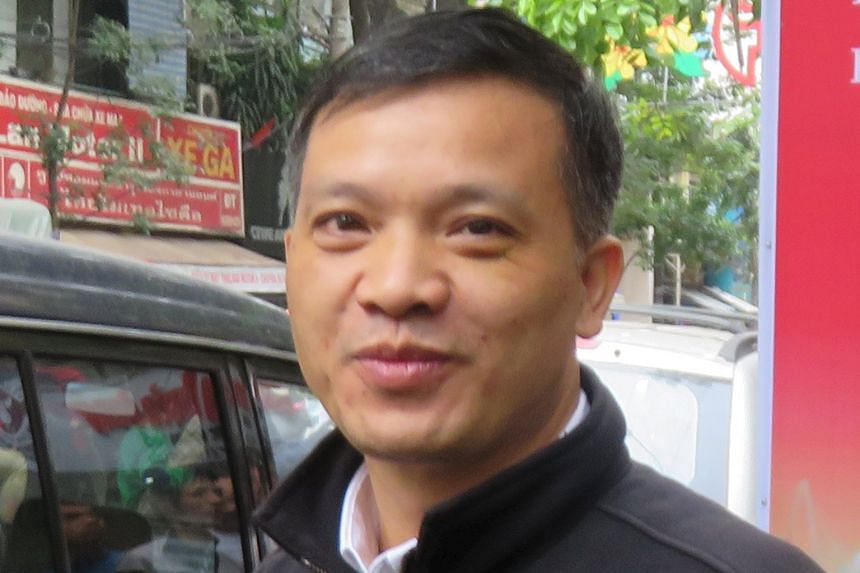 """Human rights lawyer Nguyen Van Dai (left) was arrested last week for anti-state """"propaganda""""."""