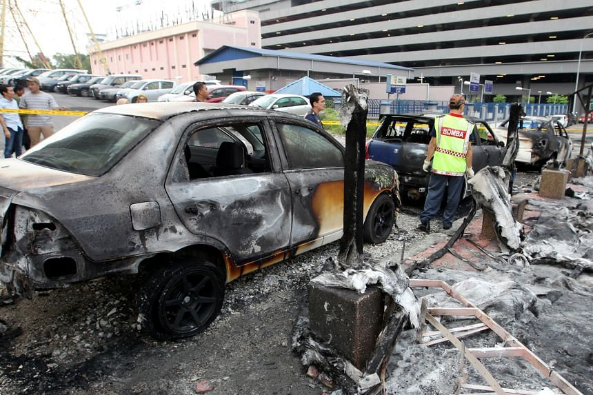 Six cars were damaged in the incident near an LRT station in Selangor on Monday. The suspect threw a petrol bomb at the car of his wife's boyfriend after an argument. The fire quickly spread to the other cars parked there, causing plumes of smoke and
