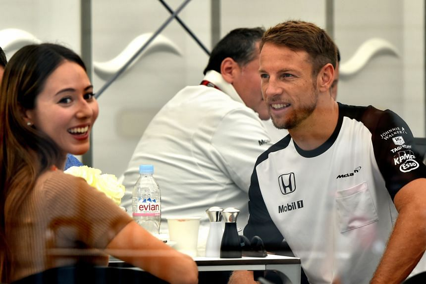 Jessica Michibata and Jenson Button relaxing in the paddock during the Japanese Grand Prix in September. The high-profile couple hardly lived together after they got married nearly a year ago.