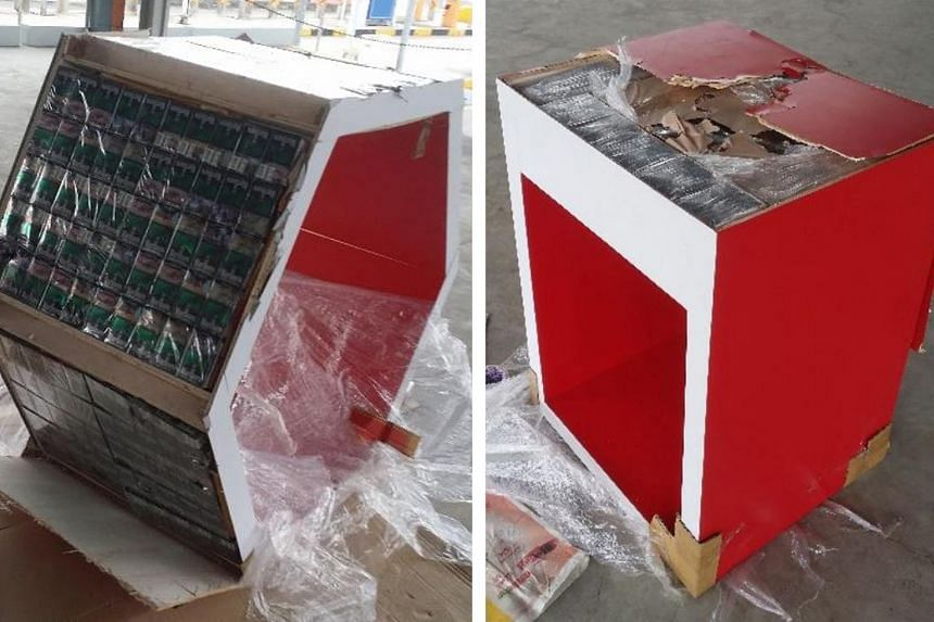 Last Friday, 1,648 cartons of cigarettes were found hidden in the base and side walls of cabinets and tables (above) in a lorry. The 48-year-old driver was arrested.