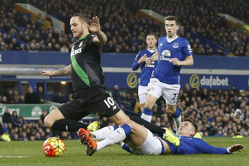 Everton's John Stones bringing down Marko Arnautovic to concede a stoppage-time penalty, which the Stoke striker converted for the visitors' winner.