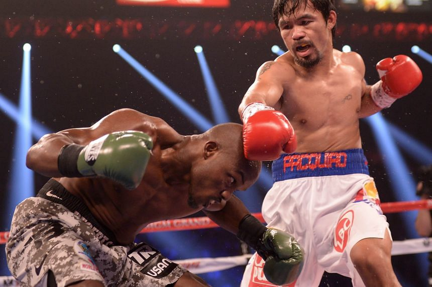 Filipino Manny Pacquiao in action against American Timothy Bradley during their WBO World Welterweight Championship title match at the MGM Grand Arena in Las Vegas in 2014.