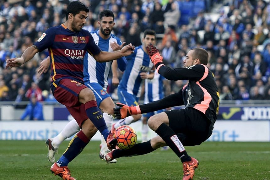Barcelona forward Luis Suarez's attempt being thwarted by Espanyol goalkeeper Pau Lopez. Both he and Lionel Messi hit the woodwork in the 0-0 draw and will need to be sharper in both legs of the teams' King's Cup clash.