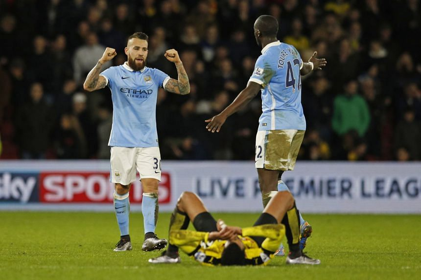 Manchester City's Nicolas Otamendi and Yaya Toure celebrating after the 2-1 victory at Vicarage Road, their first away win in the Premier League since Sept 12. They will want a similar result next at Everton in the League Cup.