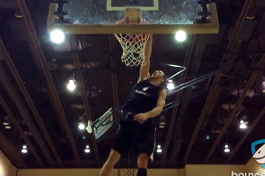 Screen shots from a YouTube video of professional dunker Jordan Kilganon's most spectacular success, flipping the basketball from behind his back while jumping (left), then spinning around to dunk. Kilganon, 23, will compete in the NBA slam dunk cont