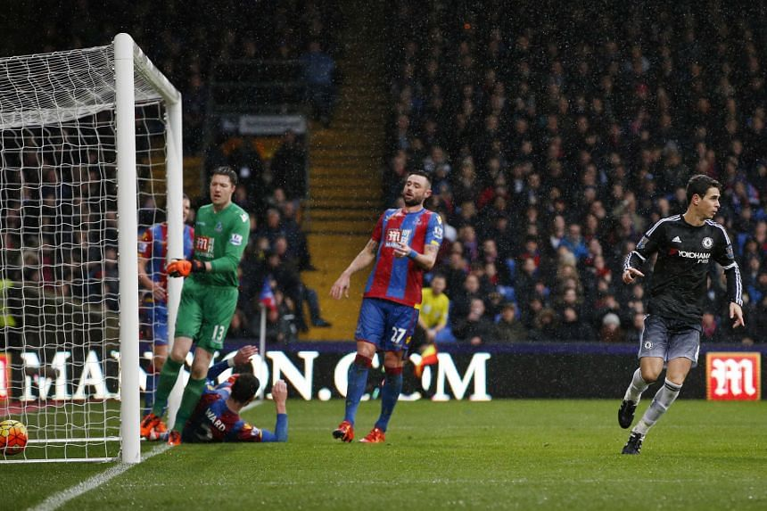 Crystal Palace players can only look on in despair, while Chelsea midfielder Oscar (right) wheels away in jubilation after scoring the opening goal at Selhurst Park in the Blues' 3-0 win.