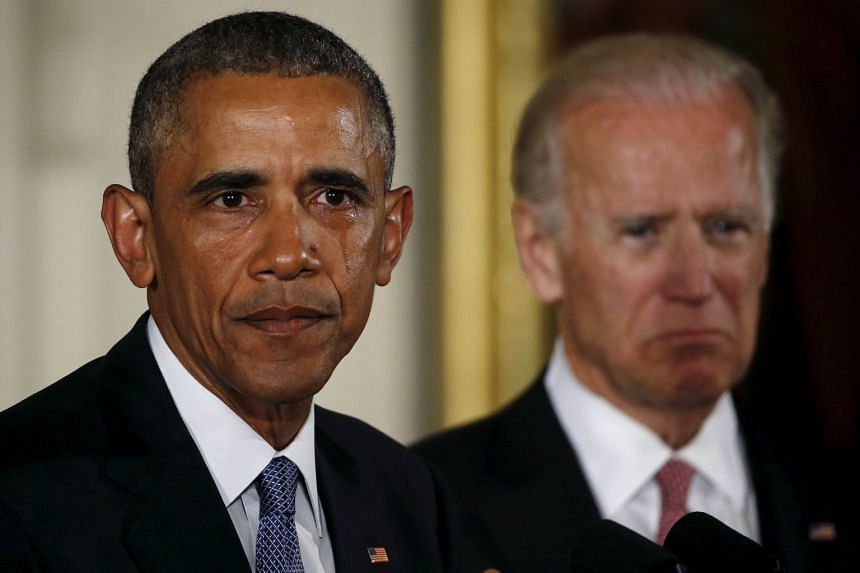 US President Barack Obama sheds tears while delivering a statement on the measures his administration is taking to reduce gun violence on Tuesday, as Vice-President Joe Biden looks on.