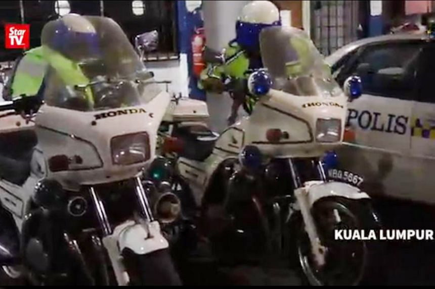 Malaysian police impounded the two Honda motorcycles after the two men riding them were found to be impersonating traffic policemen.