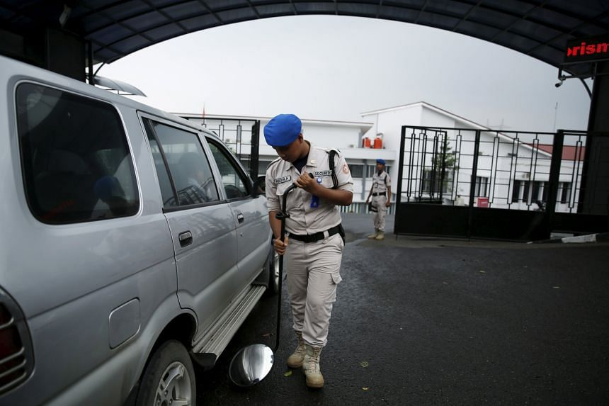A security guard checking a car outside the National Counter-Terrorism Agency building in Bogor on Tuesday. There is rising concern about possible attacks by ISIS sympathisers in Indonesia.