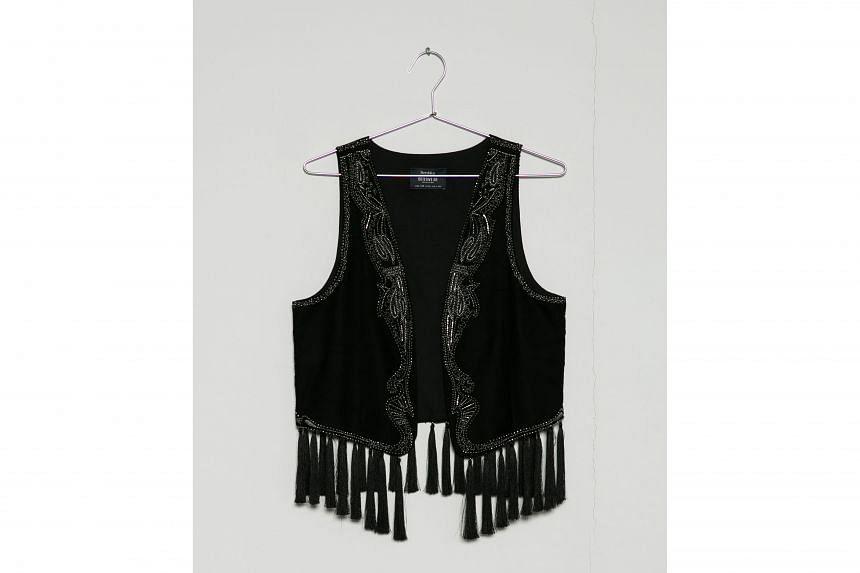 Black velvet vest with tassle.