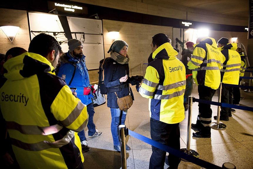 Danish security staff checking IDs at a train station outside Copenhagen on Monday. Sweden and Denmark agreed to lift temporary border checks as soon as possible but must first slow migrant flows, the European Union said.