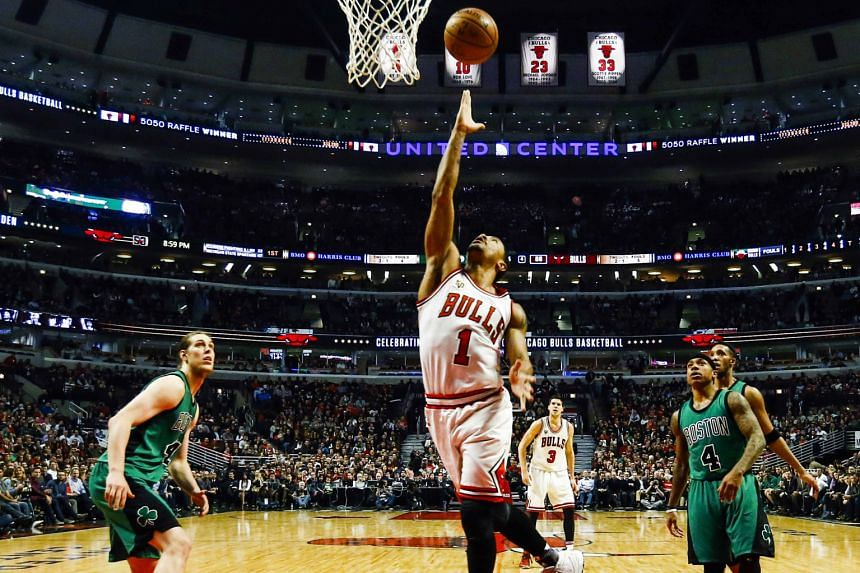 Bulls guard Derrick Rose scoring an easy basket as Celtics centre Kelly Olynyk (left) and guard Isaiah Thomas fail to keep pace at the United Centre. Chicago beat Boston 101-92 after trailing by 10 points late in the second half, netting at least 100