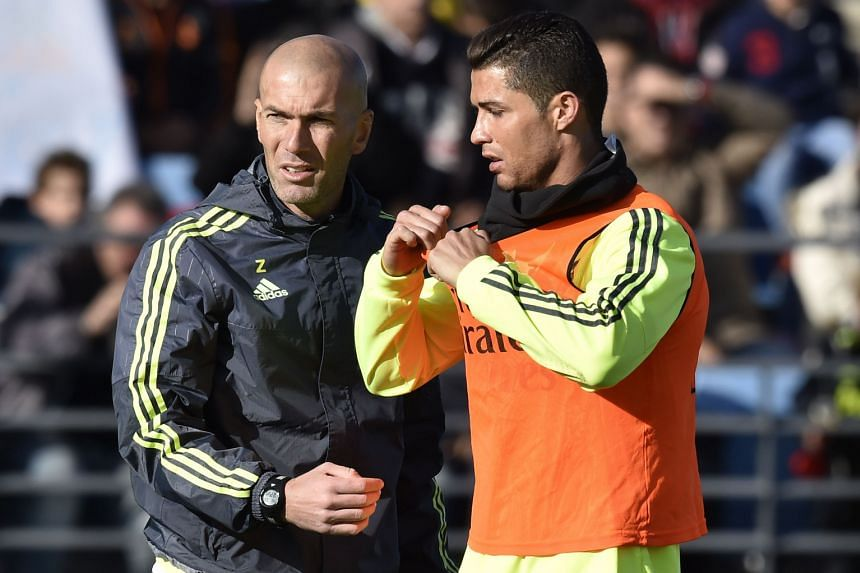 Real Madrid legend Zinedine Zidane (left) with forward Cristiano Ronaldo during his first training session as head coach on Tuesday.