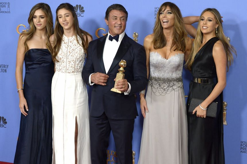 Sylvester Stallone (centre), his wife, Jennifer Flavin (second from right), and their daughters.