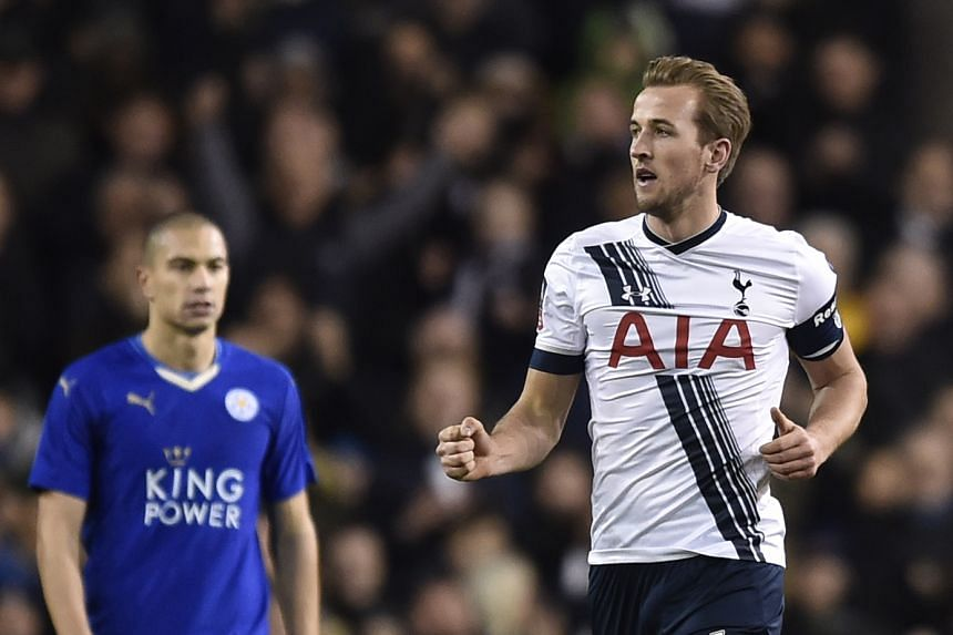 Spurs' Harry Kane (right) celebrating after scoring a last-minute penalty against Leicester to keep his team in the FA Cup.