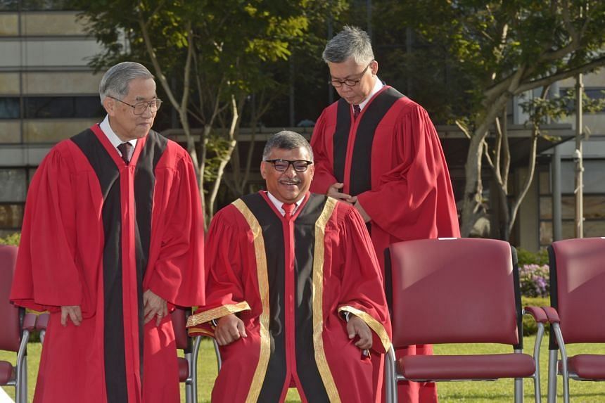 Getting ready to take their seats for the group photo at the Opening of the Legal Year 2016 yesterday are (from left) Judge of Appeal Chao Hick Tin, Chief Justice Sundaresh Menon and Justice Steven Chong.