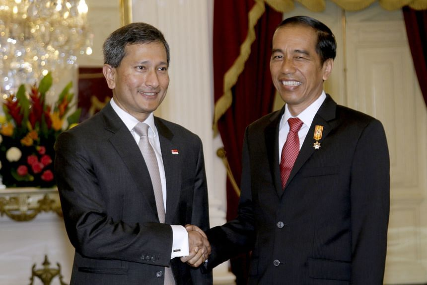 Singapore Foreign Affairs Minister Vivian Balakrishnan (far left) called on Indonesian President Joko Widodo (left) at the presidential palace in Jakarta yesterday. Dr Balakrishnan had made a two-day inaugural visit to Indonesia as Singapore's top en